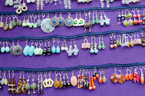 handmade colorful of various form decorative earrings jewelry sold in outdoor fair market.